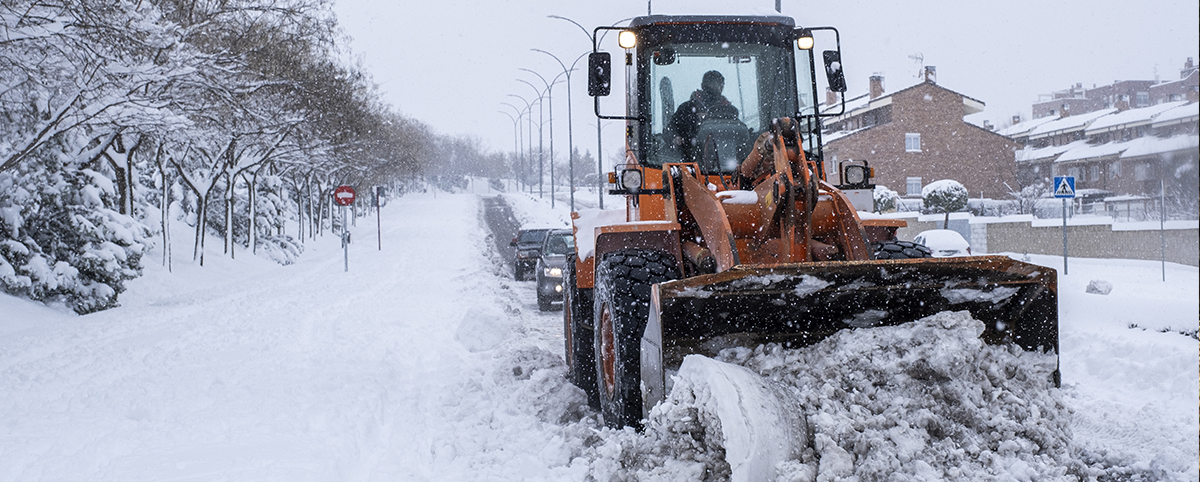 Machine Plowing Snow on Road