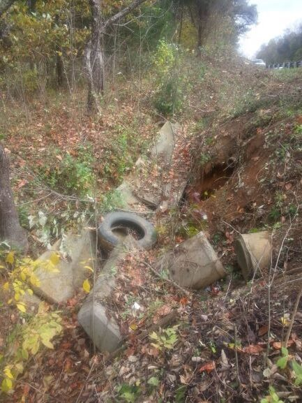 Drainage Ditch Damaged and Full of Trash