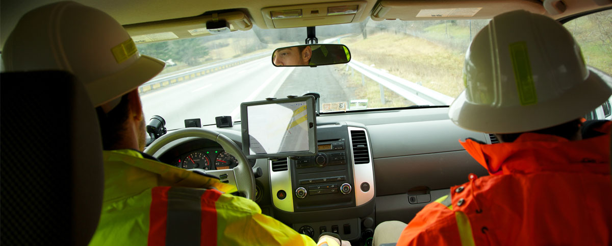 Guys in A truck Monitoring Highway