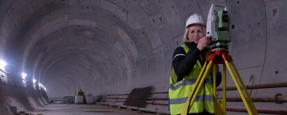 Surveyor in Underground Tunnel